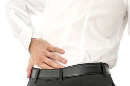 Detail of man holding his painful lower back. photo