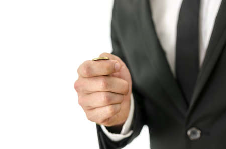 coin toss: Detail of businessman tossing a coin. Isolated over white background.