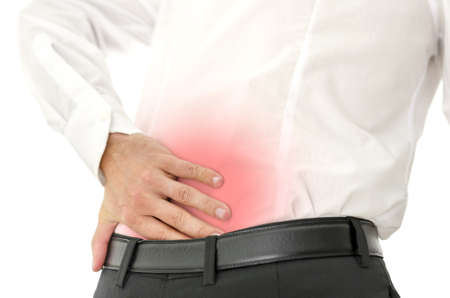back strain: Businessman holding his painful lower back. Concept of backache. Isolated over white background.