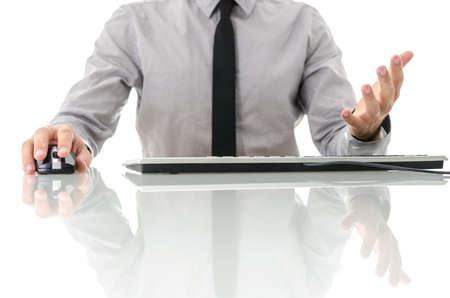man front view: Front view of businessman sitting at his white office desk using computer and is visibly frustrated. Isolated over white background. Stock Photo