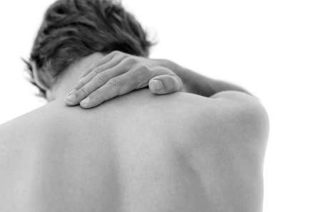 spinal disks: Detail of a man suffering from neck pain. Isolated over white background.