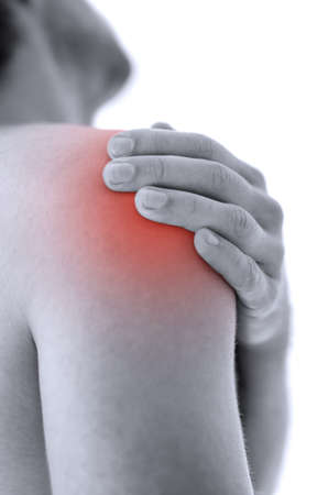 soreness: Closeup of man holding his painful injured shoulder. Over white background.
