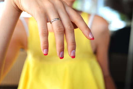 french manicure sexy woman: Closeup of woman in yellow dress with beautiful french manicure. Stock Photo