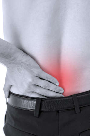 Closeup of man with lower back pain. photo