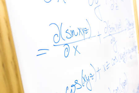 computations: Detail of complicated mathematical equation written on whiteboard. Stock Photo