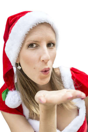 christmasy: Beautiful miss Santa sending you a kiss. Isolated over white background.