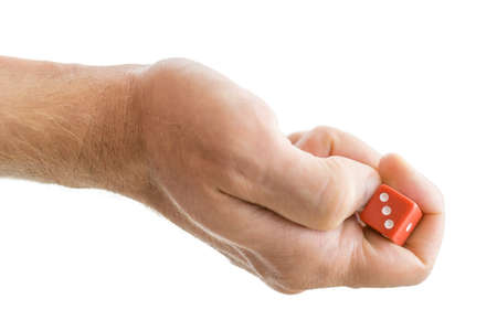 Male hand throwing dice. Isolated over white background. photo