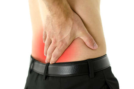 lower: Closeup of man with cramp in lower back. Stock Photo