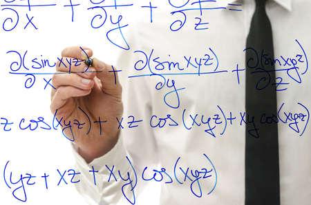 trigonometry: College teacher writing complicated mathematical equation on virtual whiteboard.
