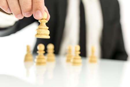 Businessman moving pawn chess figures. Concept of business strategy. Stock Photo