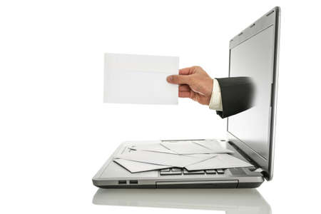 Male hand coming out of laptop monitor offering you an envelope  Isolated over white background
