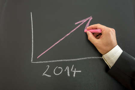 Closeup of businessman drawing growing financial business graph for year 2014  photo