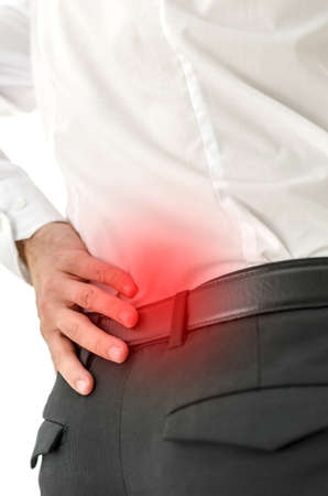 back strain: Closeup of male with lower back pain.