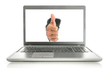 coming out: Male hand coming out of laptop monitor showing thumbs up. Isolated over white background.