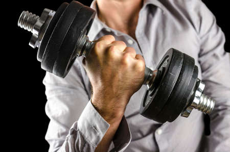 Closeup of businessman lifting heavy weights. Determination in business. Stock Photo - 22436172