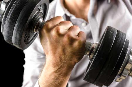 Closeup of businessman lifting weights.  Stock Photo