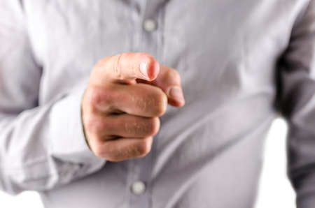 commandment: Closeup of businessman pointing finger at you.