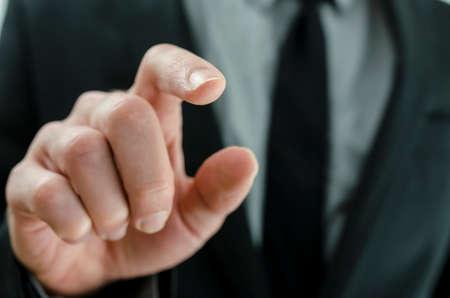 modernization: Closeup of businessman touching virtual screen.