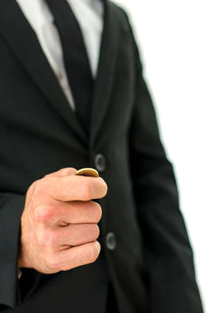Closeup of businessman tossing a coin. Concept of decision making. photo