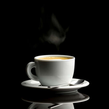 Cup of fresh hot coffee over black background. photo