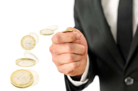 Closeup of business man tossing a coin. Motion blur.