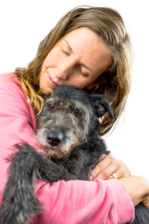 cuddly: Young woman cuddling with her dog. Concept of unconditional friendship.