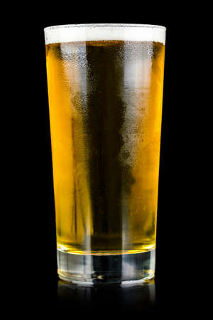 Glass of beer isolated over black background. photo