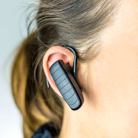 Detail of female operator with bluetooth phone. photo
