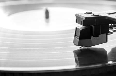 record albums: Needle over vintage record player. Music concept.