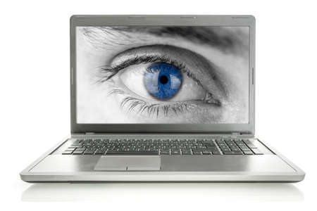 Human eye with blue pupil on laptop screen. Stock Photo - 23678804