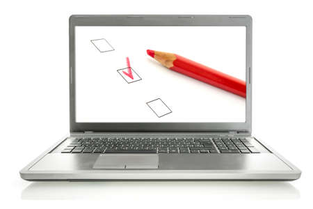 online survey: Laptop with red pencil and check boxes on screen. Online survey concept. Stock Photo