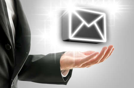 mail marketing: Businessman presenting virtual 3D email icon  Concept of global online communication  Stock Photo