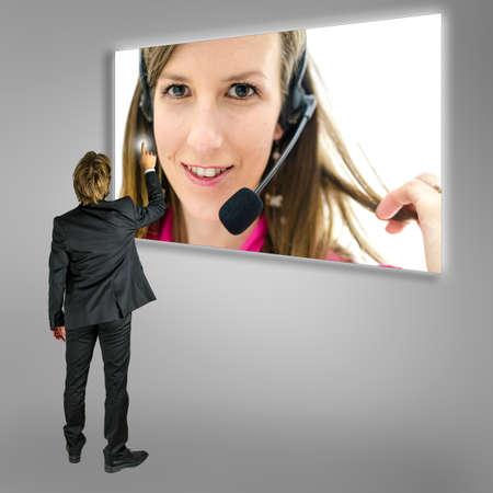 Businessman choosing online customer support on a virtual screen   photo