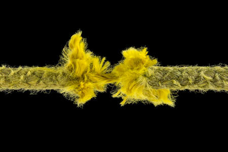 incapacity: Yellow rope just before ripping apart. Uncertainty concept.