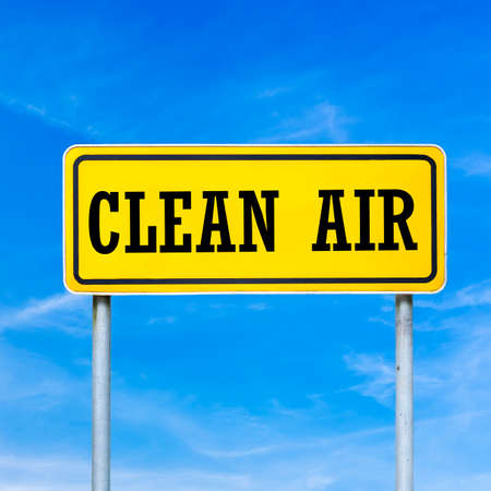 clean street: Clean air written on yellow street sign. Stock Photo