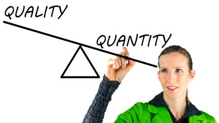 quantity: Young female drawing scale showing quality over quantity concept.