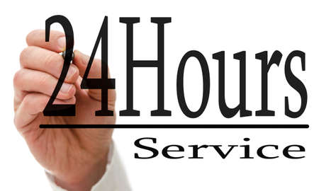 hour hand: Male hand writing 24 Hours service on virtual screen.