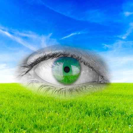 Human eye in background of beautiful nature. photo