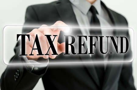 taxation: Tax refund icon on virtual screen.