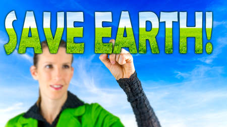 save the earth: Young female environmentalist writing Save earth sign on virtual board. Stock Photo