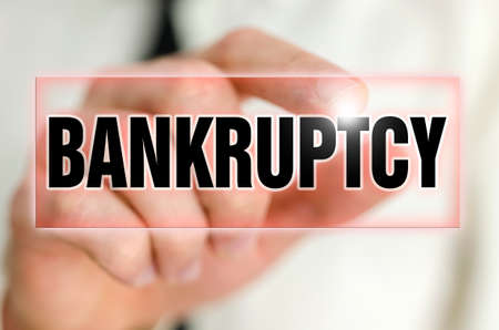 insolvency: Bankruptcy button on virtual screen.