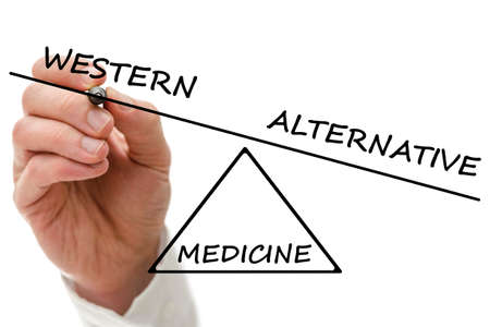 complementary therapy: Hand drawing scale with Western versus alternative medicine. Stock Photo