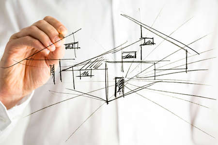 Architect drawing architectural house plan on virtual screen.