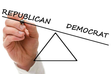 Male hand drawing a scale of Republican versus Democrat.