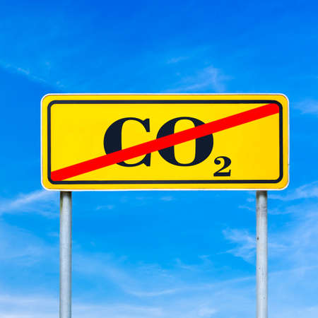 CO2 sign crossed off on a yellow road sign. photo