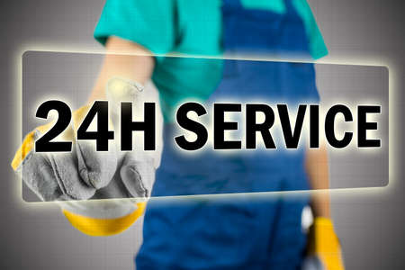 24 hour: Closeup of contractor choosing 24h service button on virtual screen. Stock Photo