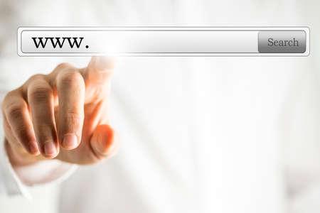 url virtual: Male hand choosing www in virtual space. Browsing internet concept.