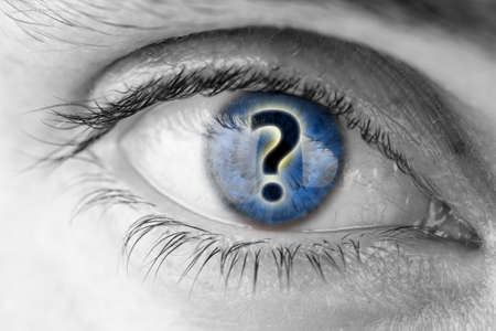 unanswered: Question mark in human eyes blue pupil. Concept of curiosity.
