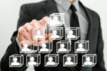 Closeup of boss arranging business hierarchy on virtual screen.