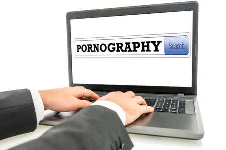 男性の手は、ポルノのネット サーフィンします。 写真素材